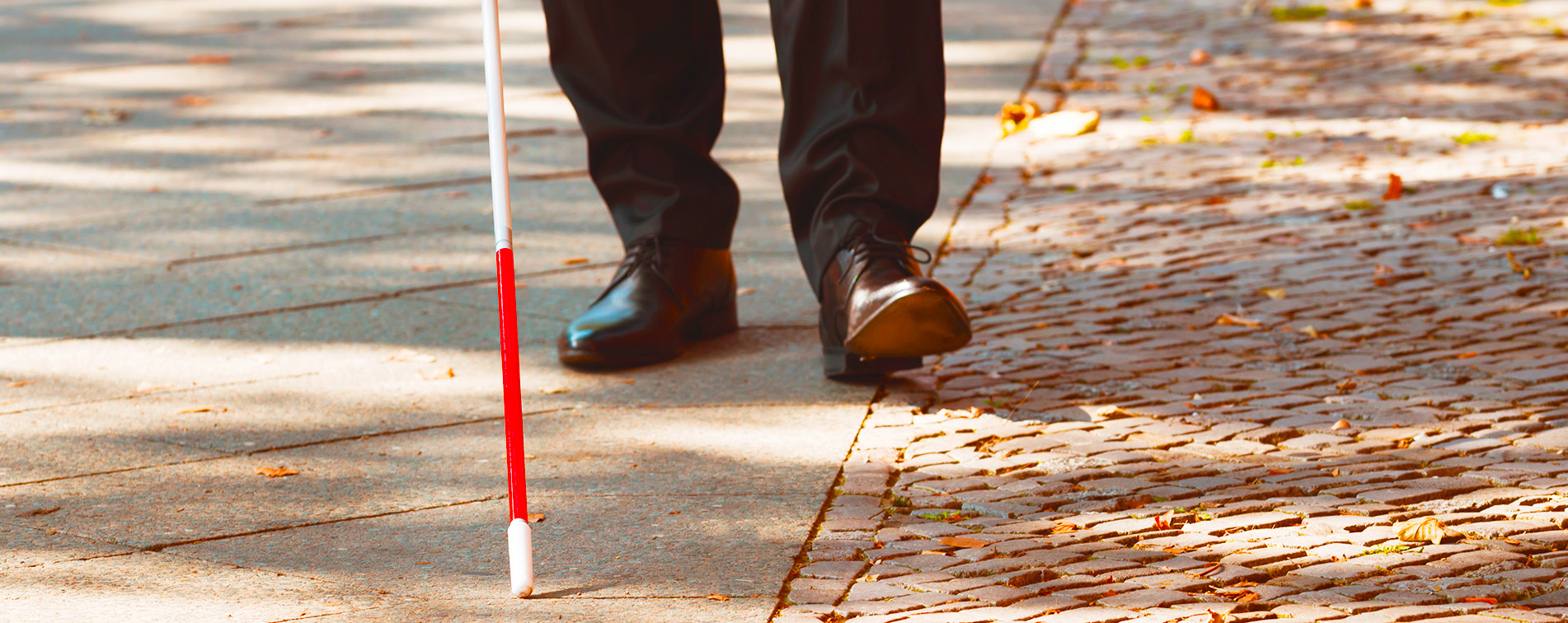 Slider Prevention & Awareness - feet walking with white cane