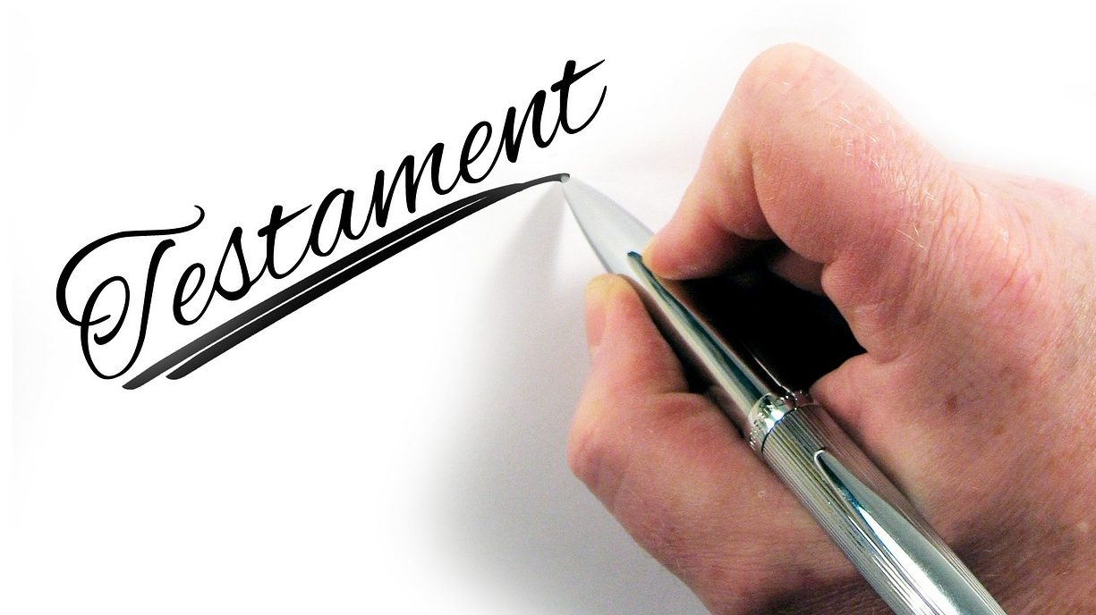 """Image associée à Faire un don - Main qui écrit """"Testament"""""""